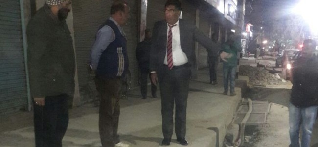 SMC Commissioner Dr Shafqat Khan overseeing construction of drainage system near a famous grocery shop in Lal Chowk here at around 9:30 p.m. on Monday