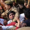 Police officer manhandles women protesters in Jammu
