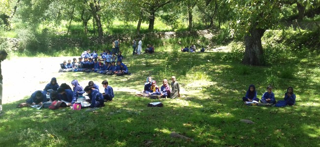 Students study on roadside after land donor locks school in Tral village