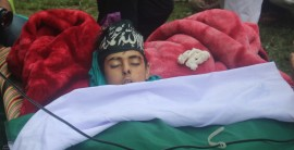 In Pics: Draped in Green flag at 11, thousands participate in Shopian boys funeral