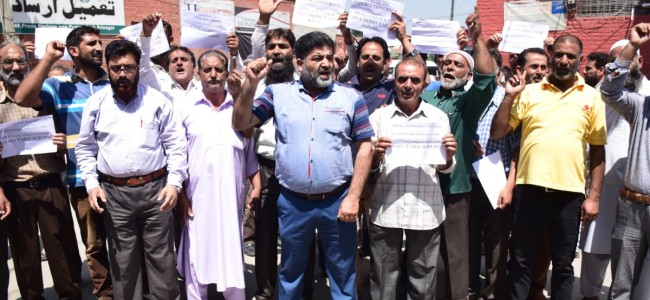 SRTC workers protest closure of Sopore yard at Press Enclave on Tuesday