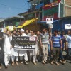 Traders body Kangan hold protest against tinkering with Article 35-A.