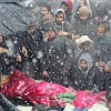People brave heavy snowfall to participate in slain LeT Commanders funeral in Pulwama, massive throng witnessed
