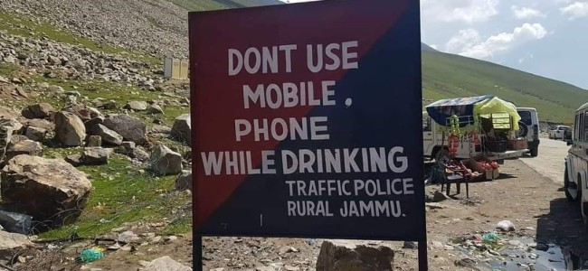 Police orders probe after signboard with 'don't use mobile phone while drinking' installed on Mughal Road