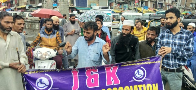Members of J&K Handicapped Association protest inside DC Anantnag's office, demand implementation of official schemes