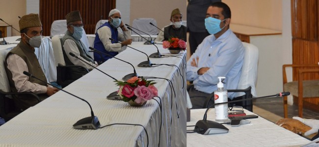 Advisor Baseer Khan interacts with religious leaders
